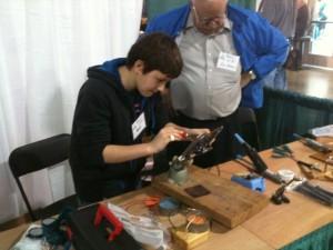 Jim teaching Nick to solder